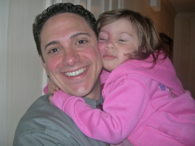 Al DeCesaris, a graduate of St. Mary's High School, hugs his niece, Jenna Heck, 9, of Davidsonville. Jenna has Sturge-Weber syndrome, a congenital neurological disorder, and a port-wine birthmark on her face, a telltale sign of SWS.