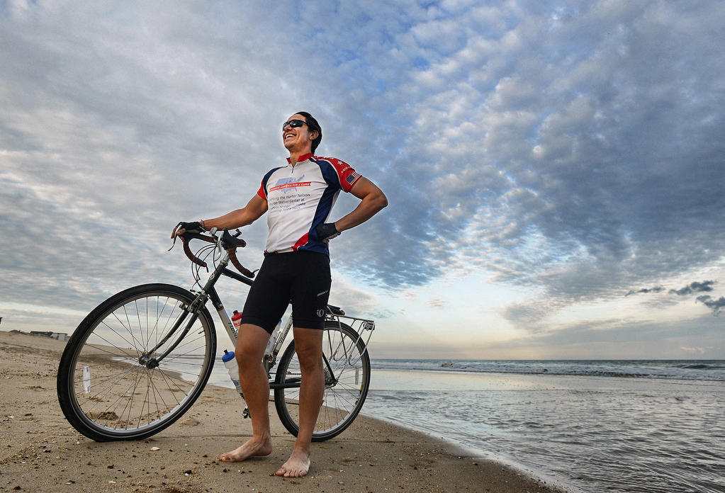 Al DeCesaris smiles as he emerges from a quick walk in the Atlantic Ocean ending his journey biking across America (photo courtesy of Grant L. Gursky).