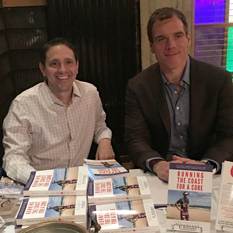"Author and advocate Al DeCesaris, left, is joined by former Pittsburgh Steelers Super Bowl XL Champion Alan Faneca at his book release party for ""Running The Coast For A Cure"" at Killarney House in Davidsonville on May 4 (Courtesy Photo)."